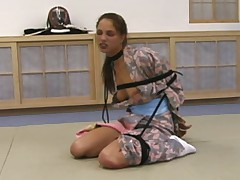 Temptress tied in a traditional kimono, obi and tabi (socks). A rope connected..