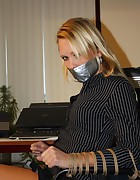 Secretary tied to chair