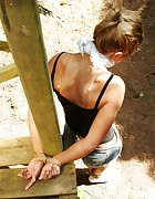 Hottie tied and cleavegagged outside burning in the hot sun