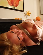 DeeDee hogtied on the bed