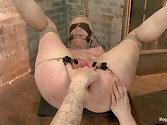 In scene one she endures a brutal push up position back arch with a harsh..