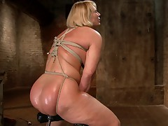 Big Ass Blonde MILF Mellanie Monroe brings her beautiful curves to HogTied for..