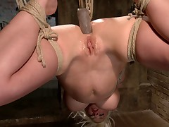 Bondage whore Leya Falcon likes getting fucked, but LOVES getting fucked while..
