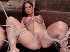 Sexy Syren's irresistible tits are tied tight and weighted in an orgasmic..