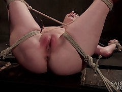 Cherry Torn begins in a predicament position that is stressing her body in all..